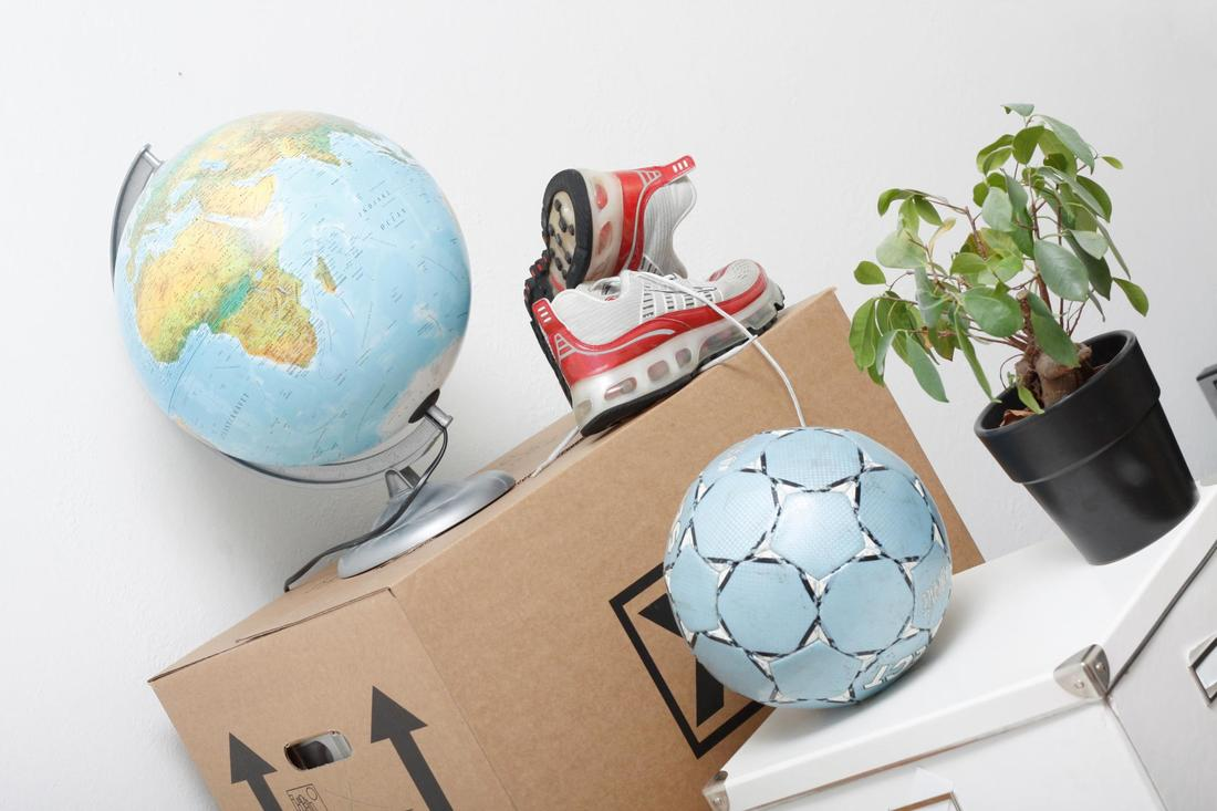 This is a picture of globe, shoes and boxes prepared for moving.